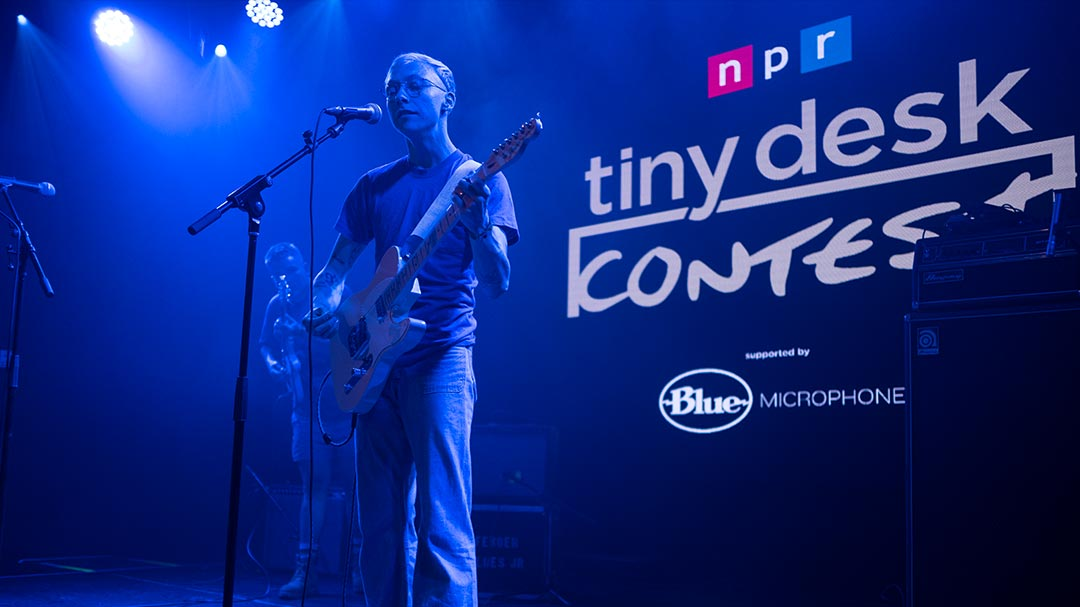 2019 Tiny Desk Contest winner and guitarist Quinn Christopherson performs on stage with bandmate Nick Carpenter